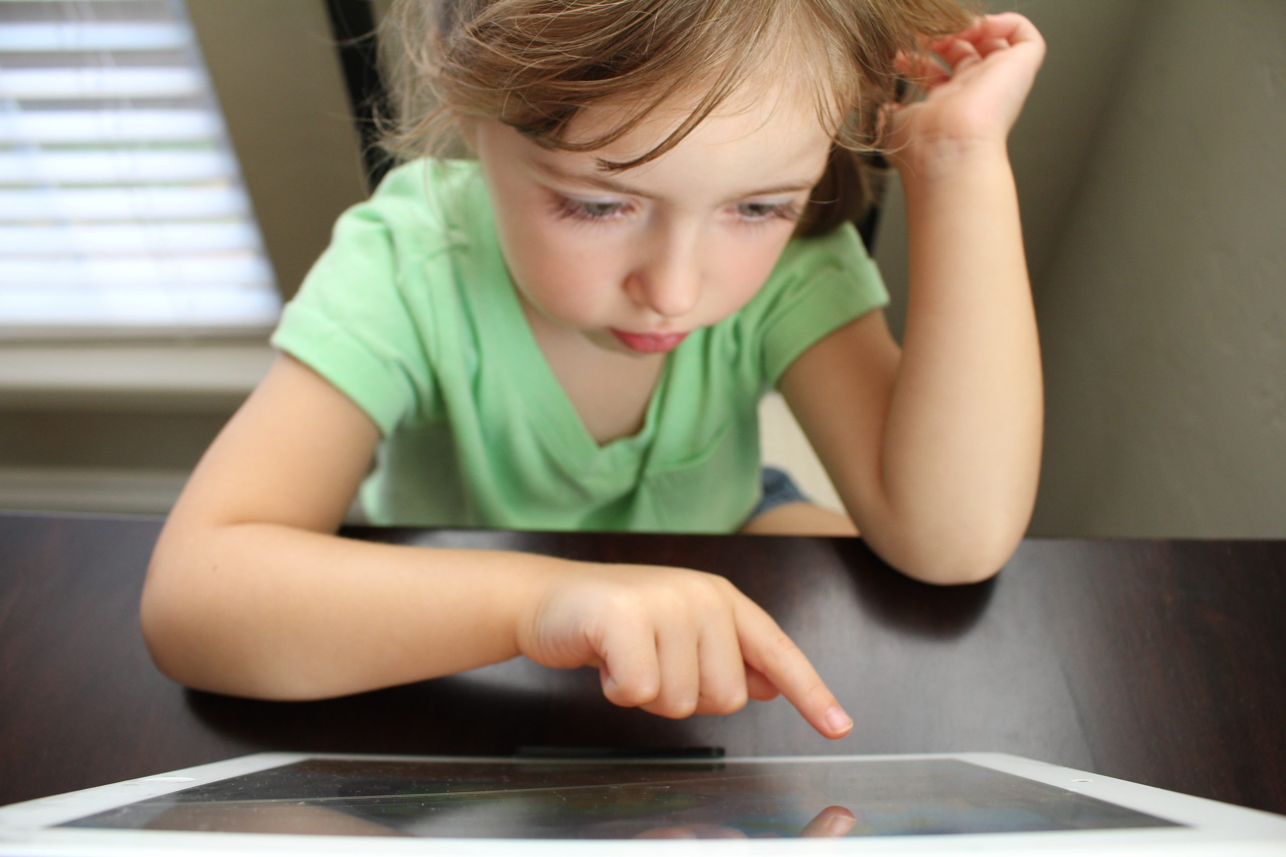 girl learning using iPad